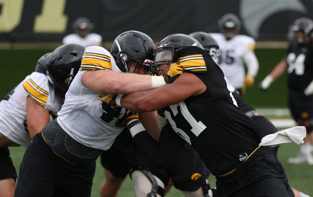 Iowa Hawkeyes defensive end Parker Hesse (40) and tight end Noah Fant (87) during practice No. 4 of Fall Camp Monday, August 6, 2018 at the Hansen Football Performance Center. (Brian Ray/hawkeyesports.com)
