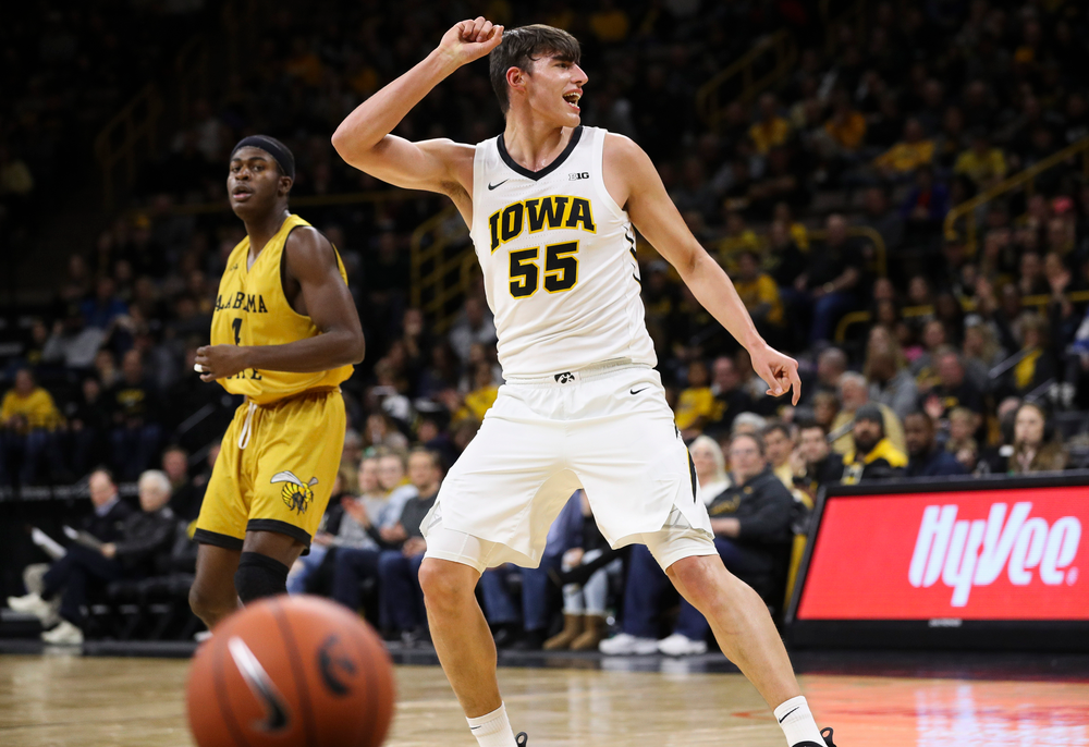 Iowa Hawkeyes forward Luka Garza (55) reacts after hitting a 3-pointer during a game against Alabama State at Carver-Hawkeye Arena on November 21, 2018. (Tork Mason/hawkeyesports.com)