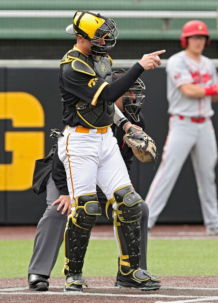 Iowa Hawkeyes catcher Austin Martin (34) points to pitcher Trenton Wallace (not pictured) after a strikeout during the second inning of their game against Illinois State at Duane Banks Field in Iowa City on Wednesday, Apr. 3, 2019. (Stephen Mally/hawkeyesports.com)