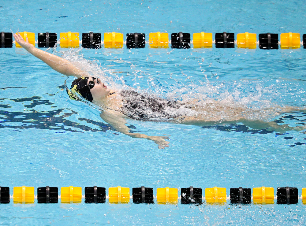Iowa's Zoe Pawloski swims the women's 100-yard backstroke event during their meet against Michigan State and Northern Iowa at the Campus Recreation and Wellness Center in Iowa City on Friday, Oct 4, 2019. (Stephen Mally/hawkeyesports.com)