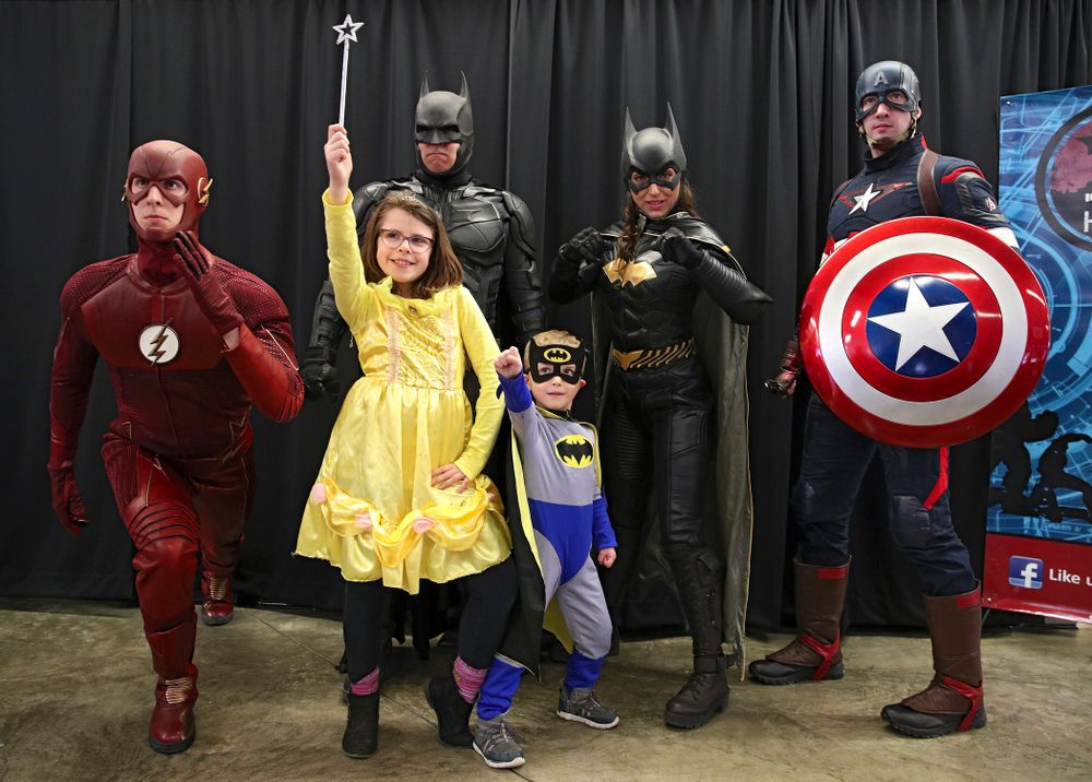 Two fans get a picture with a group of superheroes on Superhero and Princess Day before the meet at Carver-Hawkeye Arena in Iowa City on Sunday, March 8, 2020. (Stephen Mally/hawkeyesports.com)