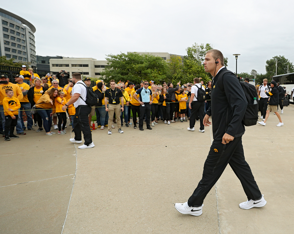 Iowa Hawkeyes quarterback Nate Stanley (4) arrives with his team before their game at Kinnick Stadium in Iowa City on Saturday, Sep 28, 2019. (Stephen Mally/hawkeyesports.com)