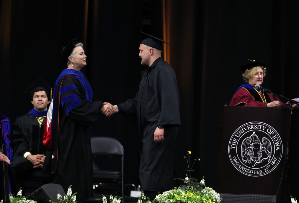 Hawkeye Footballs Brady Ross during the Tippie College of Business spring commencement Saturday, May 11, 2019 at Carver-Hawkeye Arena. (Brian Ray/hawkeyesports.com)