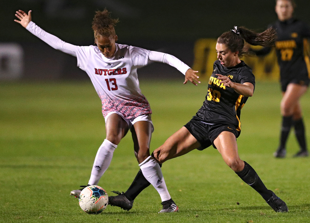 Iowa forward Devin Burns (30) tries to poke the ball away during the first half of their match at the Iowa Soccer Complex in Iowa City on Friday, Oct 11, 2019. (Stephen Mally/hawkeyesports.com)
