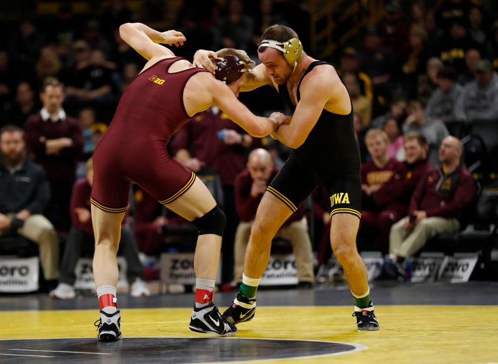 Iowa's Joey Gunther wrestles Minnesota's Chris Pfarr at 174 pounds