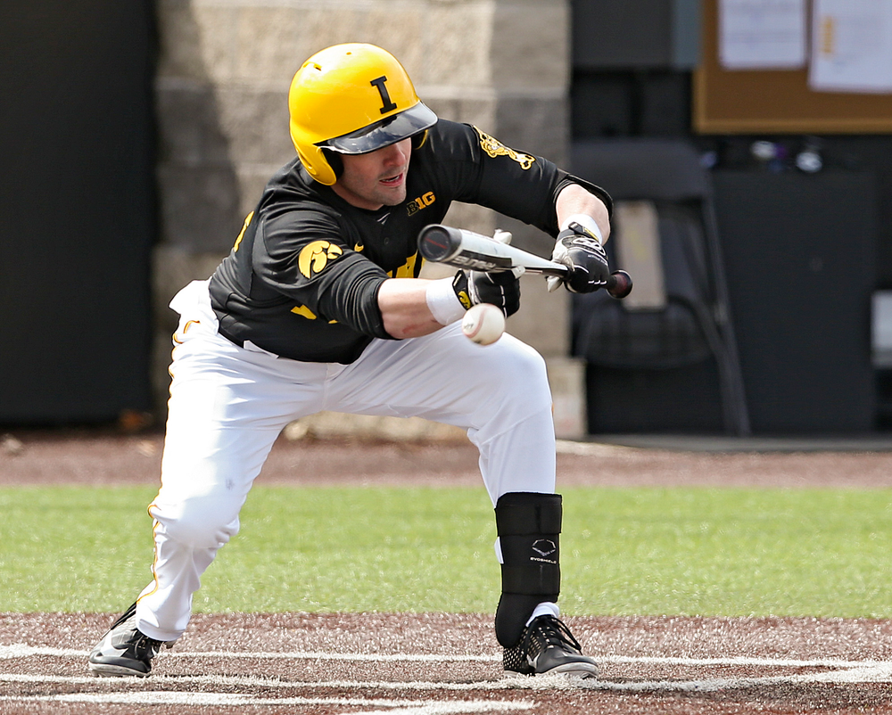 Iowa Hawkeyes designated hitter Chris Whelan (28) lays down a sacrifice bunt during the second inning of their game against Illinois at Duane Banks Field in Iowa City on Saturday, Mar. 30, 2019. (Stephen Mally/hawkeyesports.com)