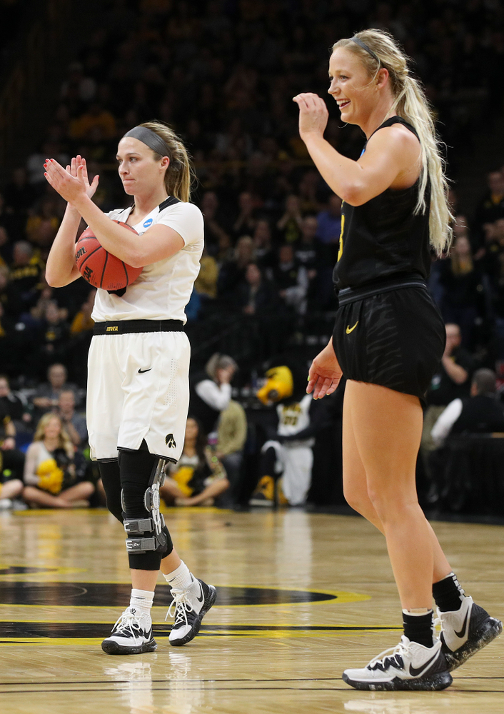 Iowa Hawkeyes guard Makenzie Meyer (3) claps after is was fouled by Missouri Tigers guard Sophie Cunningham (3) during the second quarter of their second round game in the 2019 NCAA Women's Basketball Tournament at Carver Hawkeye Arena in Iowa City on Sunday, Mar. 24, 2019. (Stephen Mally for hawkeyesports.com)