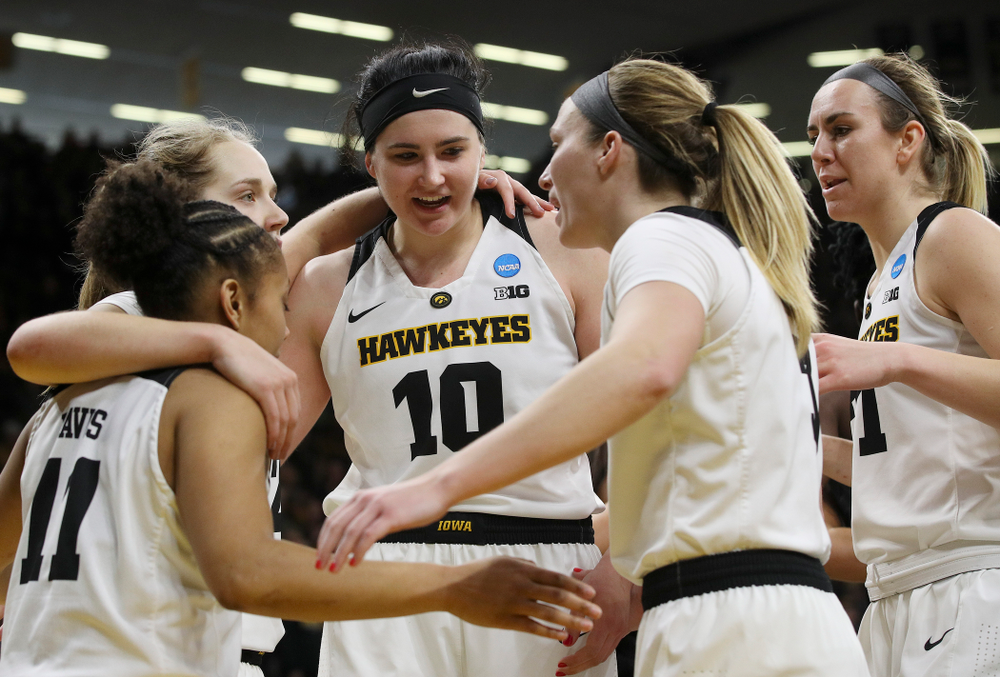 Iowa Hawkeyes guard Tania Davis (11), guard Kathleen Doyle (22), center Megan Gustafson (10), guard Makenzie Meyer (3), and forward Hannah Stewart (21) huddle and talk during the fourth quarter of their second round game in the 2019 NCAA Women's Basketball Tournament at Carver Hawkeye Arena in Iowa City on Sunday, Mar. 24, 2019. (Stephen Mally for hawkeyesports.com)