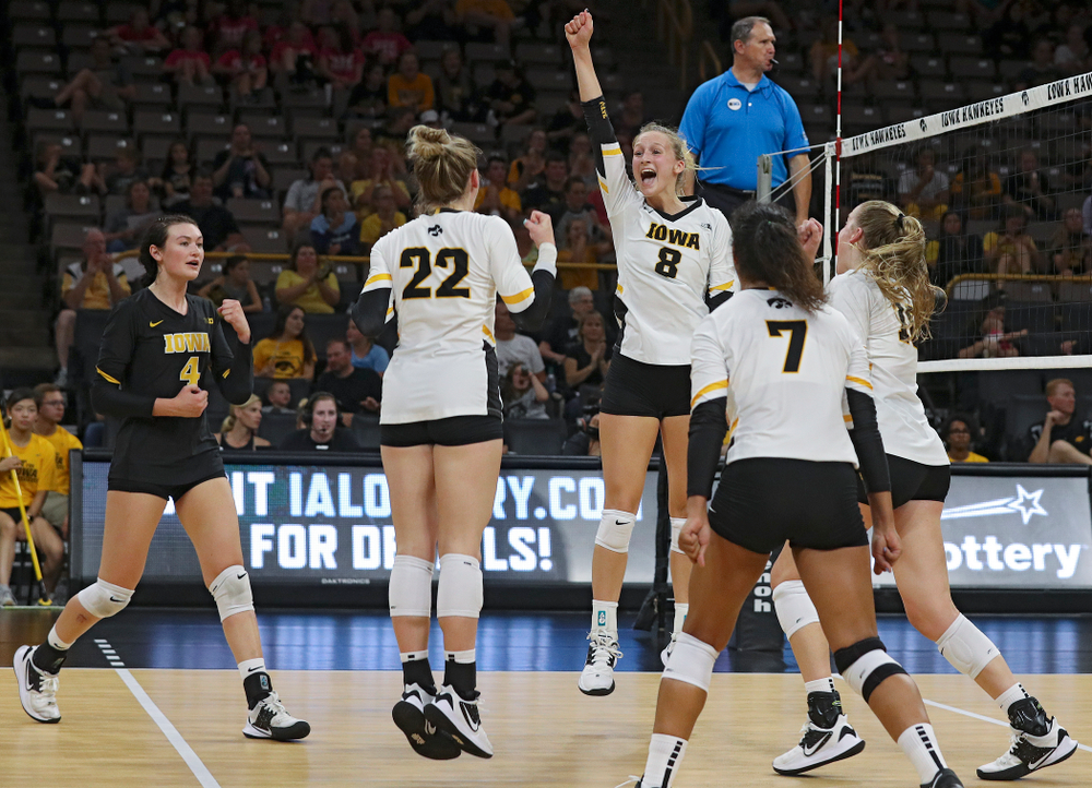 Iowa's Halle Johnston (4), Jaedynn Evans (22) Brie Orr (7), and Hannah Clayton (18) celebrate with Kyndra Hansen (8) after her kill during the third set of their Big Ten/Pac-12 Challenge match against Colorado at Carver-Hawkeye Arena in Iowa City on Friday, Sep 6, 2019. (Stephen Mally/hawkeyesports.com)