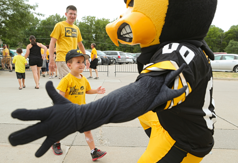 A young fan greets Herky during Kids Day at Kinnick Stadium in Iowa City on Saturday, Aug 10, 2019. (Stephen Mally/hawkeyesports.com)