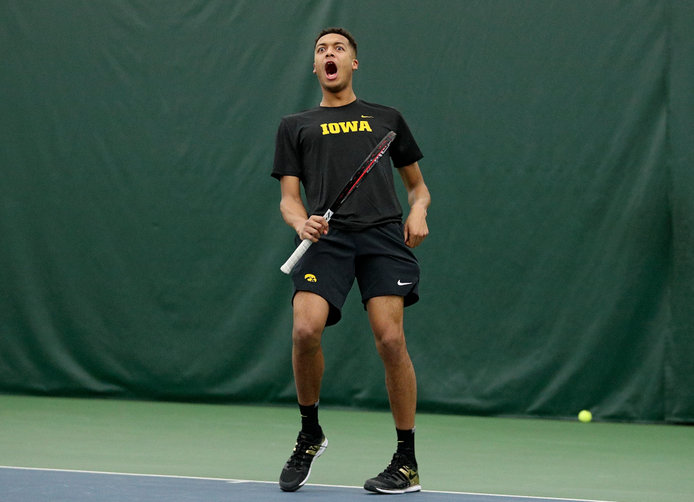 Iowa's Oliver Okonkwo celebrates during his doubles match at the Hawkeye Tennis and Recreation Complex in Iowa City on Thursday, January 16, 2020. (Stephen Mally/hawkeyesports.com)