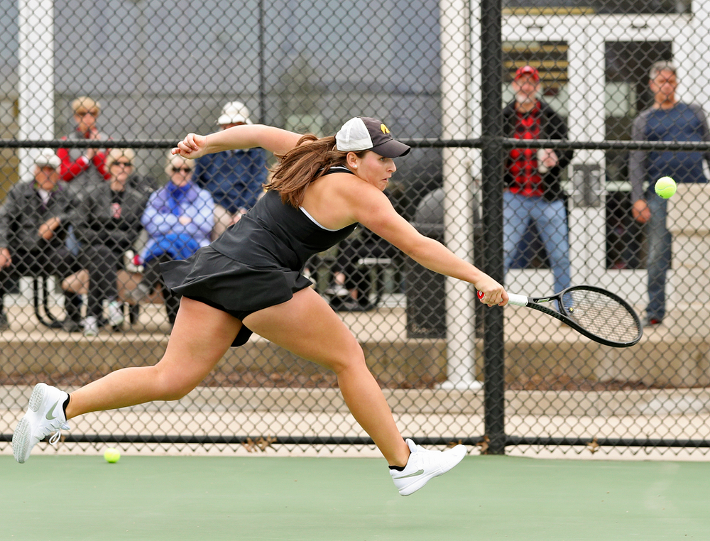 Iowa's Danielle Bauers runs down a ball during their doubles match against Rutgers at the Hawkeye Tennis and Recreation Complex in Iowa City on Friday, Apr. 5, 2019. (Stephen Mally/hawkeyesports.com)