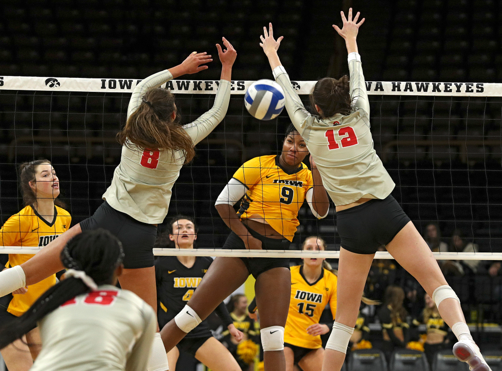 Iowa's Amiya Jones (9) gets a kill during the first set of their match at Carver-Hawkeye Arena in Iowa City on Friday, Nov 29, 2019. (Stephen Mally/hawkeyesports.com)