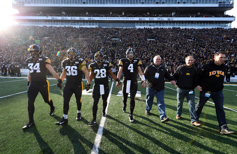 Iowa Hawkeyes captains linebacker Kristian Welch (34), fullback Brady Ross (36), running back Toren Young (28), and quarterback Nate Stanley (4) against the Minnesota Golden Gophers Saturday, November 16, 2019 at Kinnick Stadium. (Brian Ray/hawkeyesports.com)