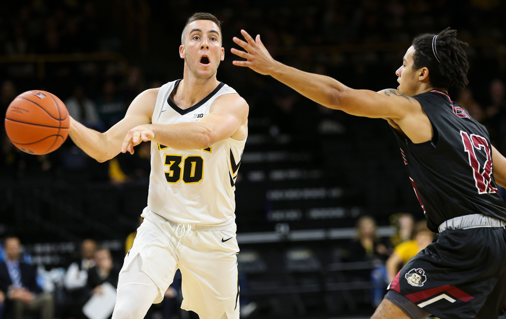 Iowa Hawkeyes guard Connor McCaffery (30) makes a no-look pass during a game against Guilford College at Carver-Hawkeye Arena on November 4, 2018. (Tork Mason/hawkeyesports.com)