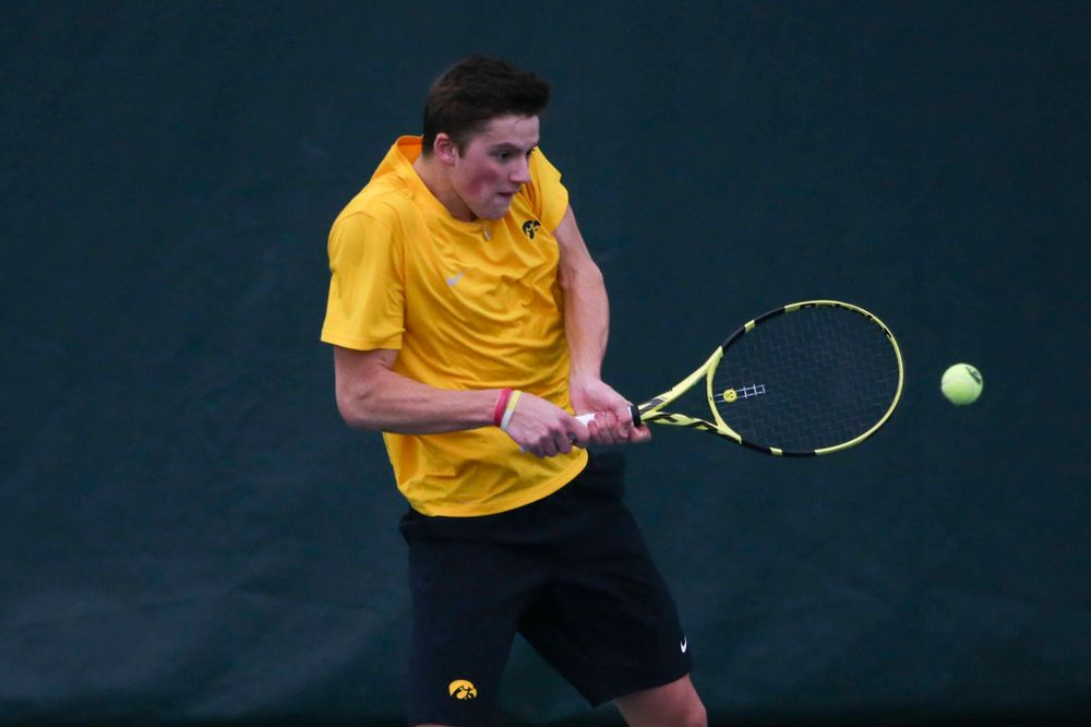Iowa's Piotr Smietana at a tennis match vs Drake  Friday, March 8, 2019 at the Hawkeye Tennis and Recreation Complex. (Lily Smith/hawkeyesports.com)