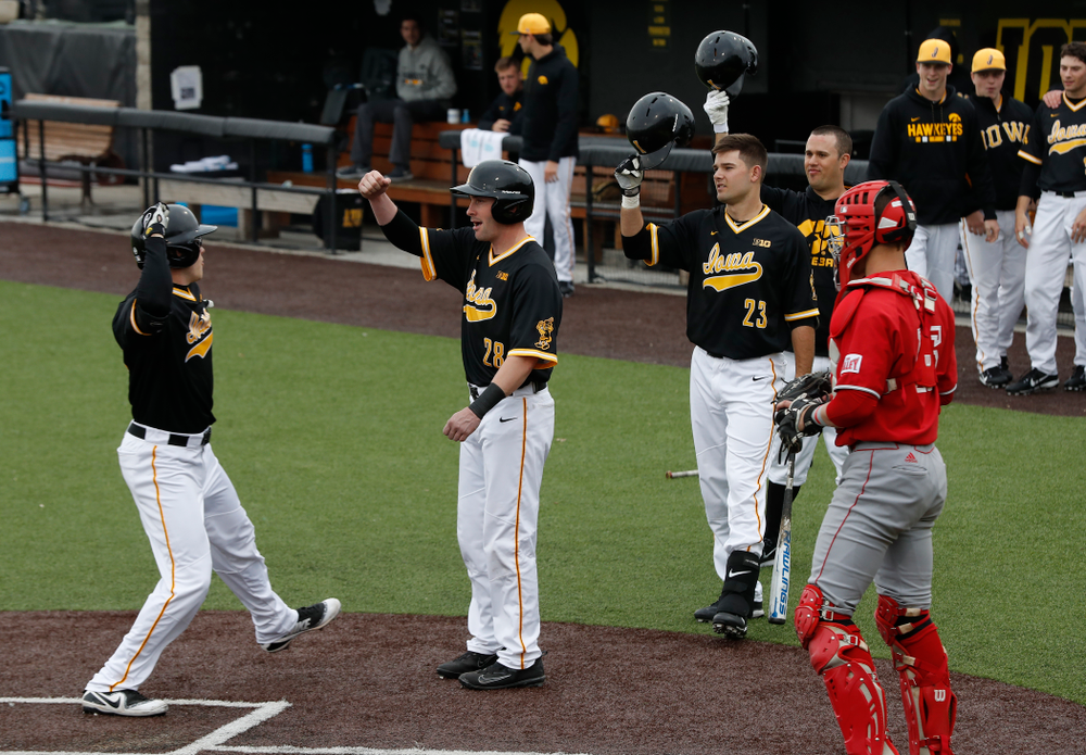 Iowa Hawkeyes catcher Austin Guzzo (20) and infielder Chris Whelan (28) against the Bradley Braves Wednesday, March 28, 2018 at Duane Banks Field. (Brian Ray/hawkeyesports.com)