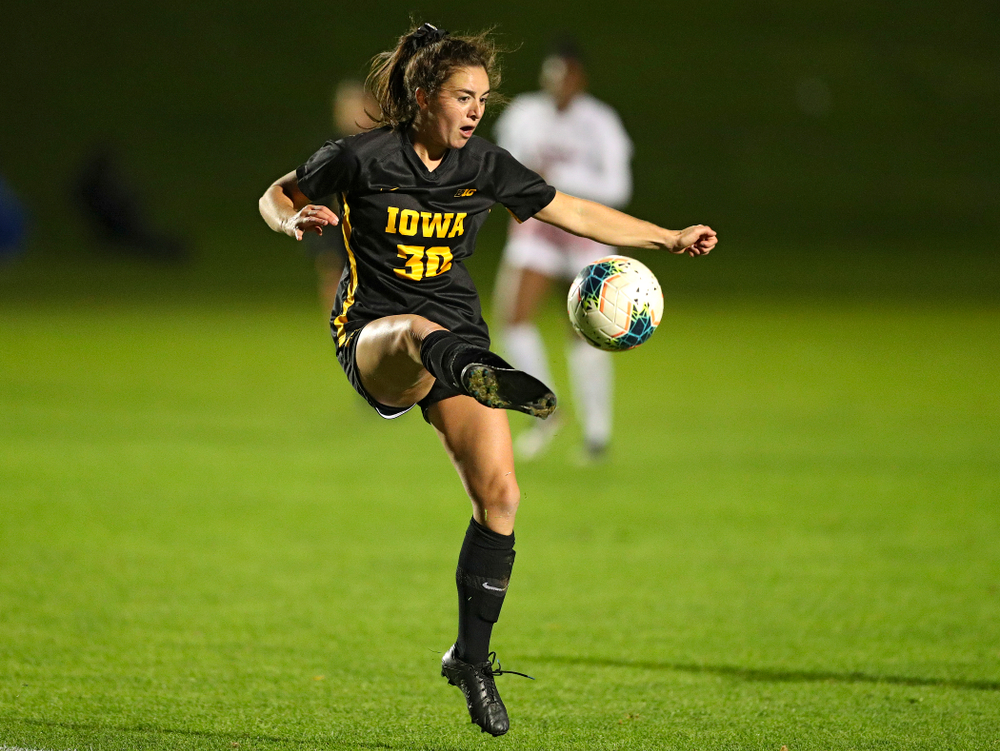 Iowa forward Devin Burns (30) passes the ball during the second half of their match at the Iowa Soccer Complex in Iowa City on Friday, Oct 11, 2019. (Stephen Mally/hawkeyesports.com)