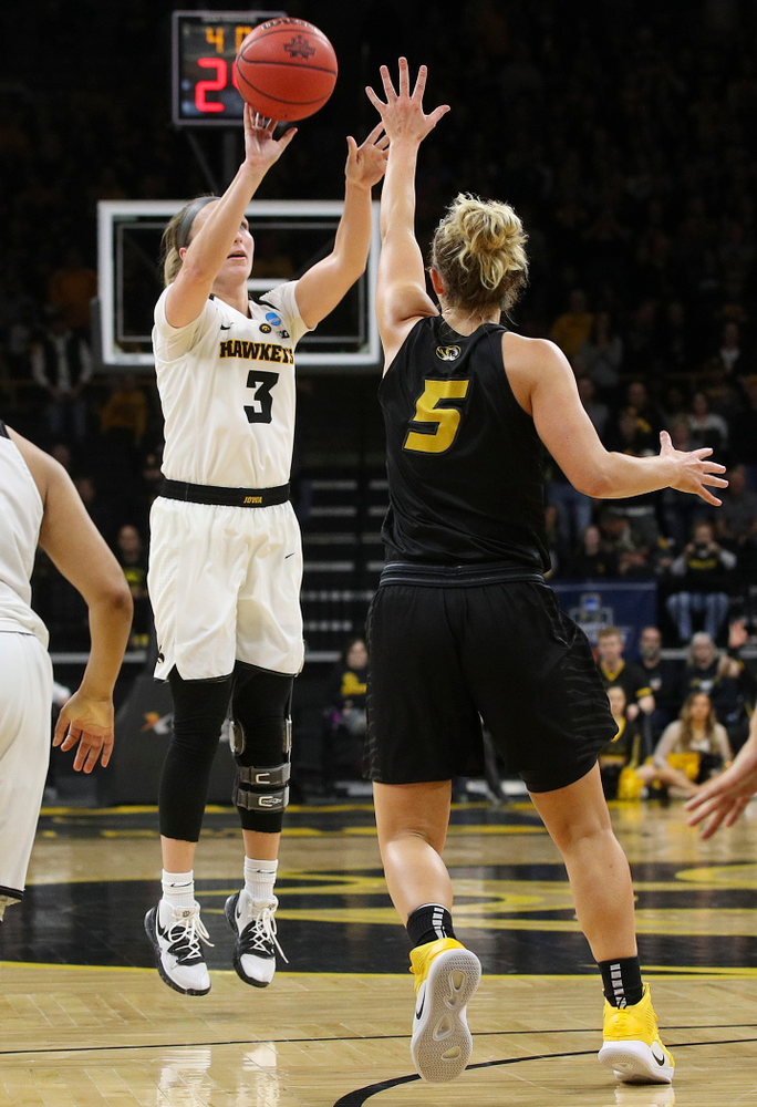 Iowa Hawkeyes guard Makenzie Meyer (3) makes a 3-pointer during the second quarter of their second round game in the 2019 NCAA Women's Basketball Tournament at Carver Hawkeye Arena in Iowa City on Sunday, Mar. 24, 2019. (Stephen Mally for hawkeyesports.com)