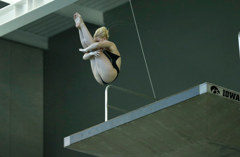 Thelma Strandburg competes off the 10 meter platform