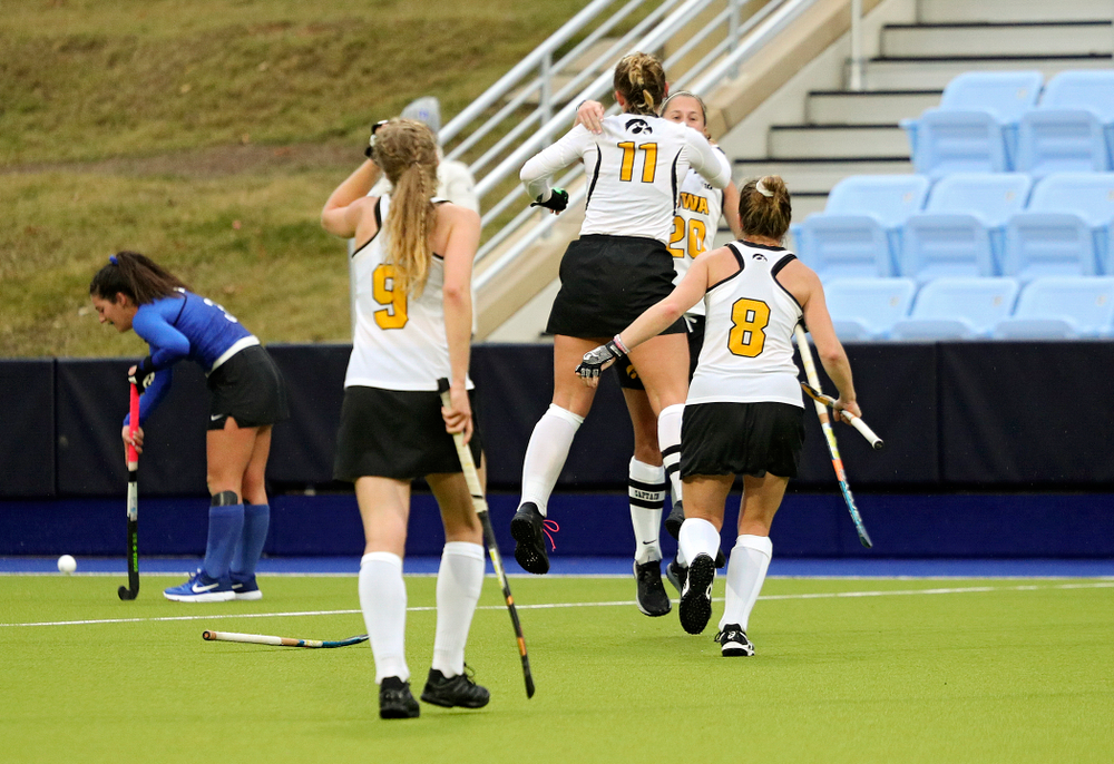 Iowa's Katie Birch (11) celebrates with Sophie Sunderland (20) as Sofie Stribos (9) and Nikki Freeman (8) come running in after winning their NCAA Tournament First Round match against Duke at Karen Shelton Stadium in Chapel Hill, N.C. on Friday, Nov 15, 2019. (Stephen Mally/hawkeyesports.com)