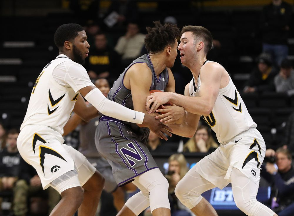 Iowa Hawkeyes guard Isaiah Moss (4) and guard Connor McCaffery (30) against the Northwestern Wildcats Sunday, February 10, 2019 at Carver-Hawkeye Arena. (Brian Ray/hawkeyesports.com)