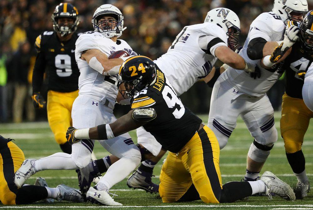 Iowa Hawkeyes defensive lineman Cedrick Lattimore (95) makes a tackle during a game against Northwestern at Kinnick Stadium on November 10, 2018. (Tork Mason/hawkeyesports.com)