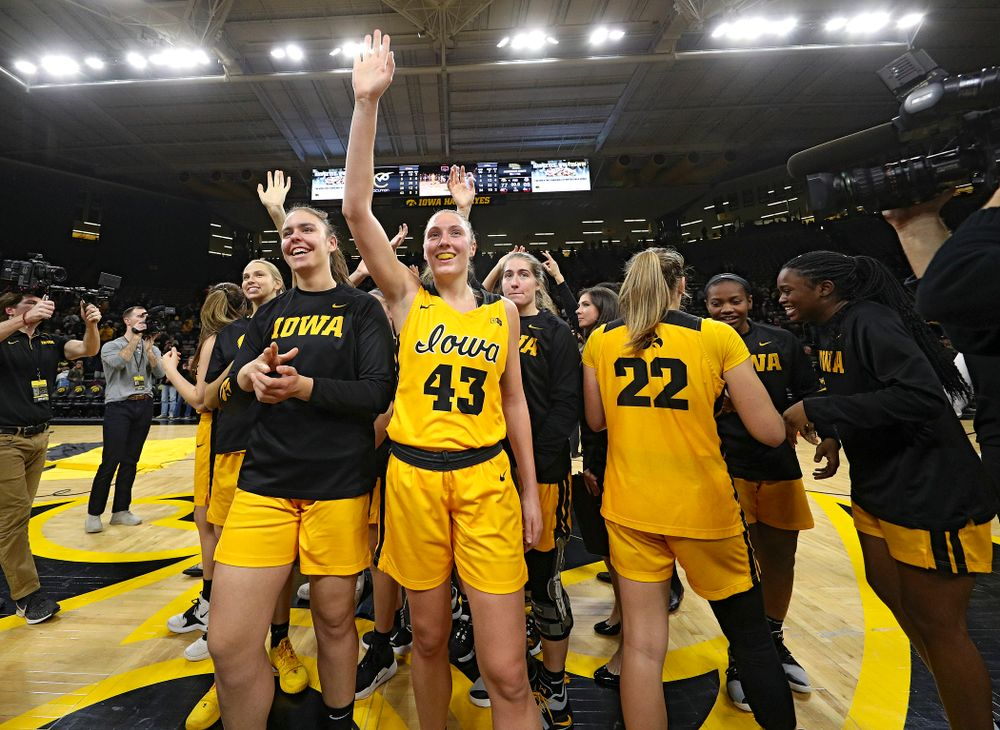 Iowa Hawkeyes forward Paula Valino Ramos (31) and forward Amanda Ollinger (43) acknowledge the crowd after winning their game at Carver-Hawkeye Arena in Iowa City on Thursday, January 23, 2020. (Stephen Mally/hawkeyesports.com)