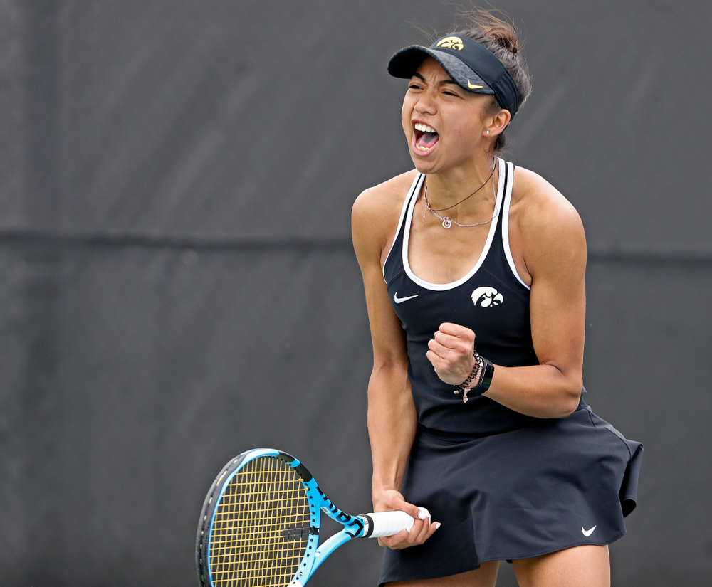 Iowa's Michelle Bacalla celebrates after winning her match against Rutgers at the Hawkeye Tennis and Recreation Complex in Iowa City on Friday, Apr. 5, 2019. (Stephen Mally/hawkeyesports.com)