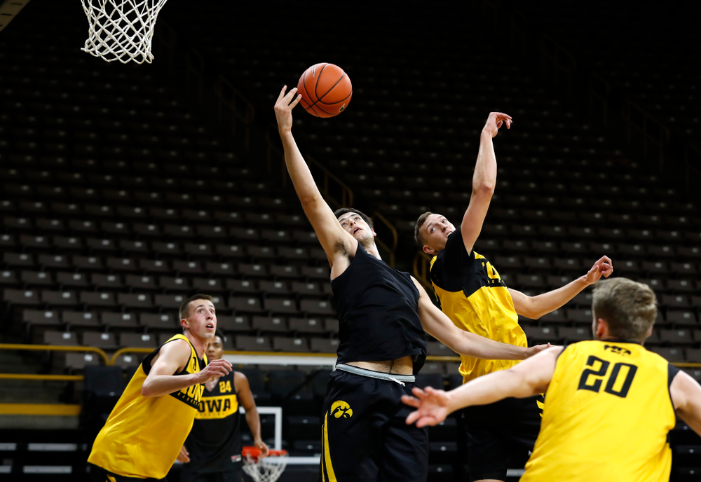 Iowa Hawkeyes forward Ryan Kriener (15) grabs a rebound during the first practice of the season Monday, October 1, 2018 at Carver-Hawkeye Arena. (Brian Ray/hawkeyesports.com)