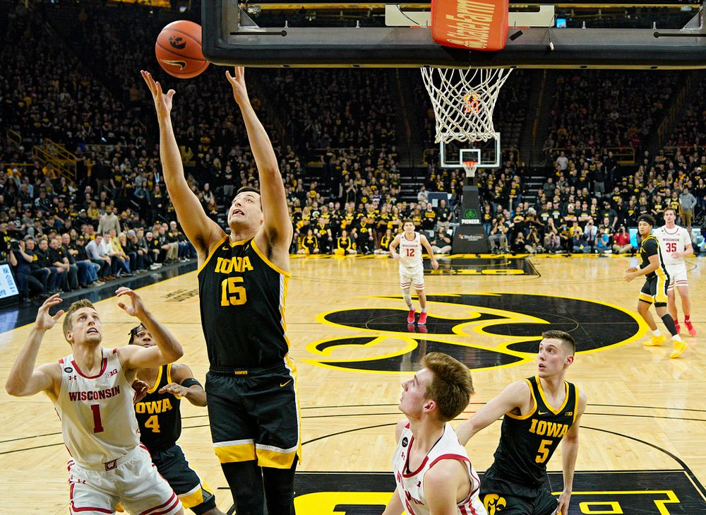 Iowa Hawkeyes forward Ryan Kriener (15) pulls in a rebound during the first half of their game at Carver-Hawkeye Arena in Iowa City on Monday, January 27, 2020. (Stephen Mally/hawkeyesports.com)
