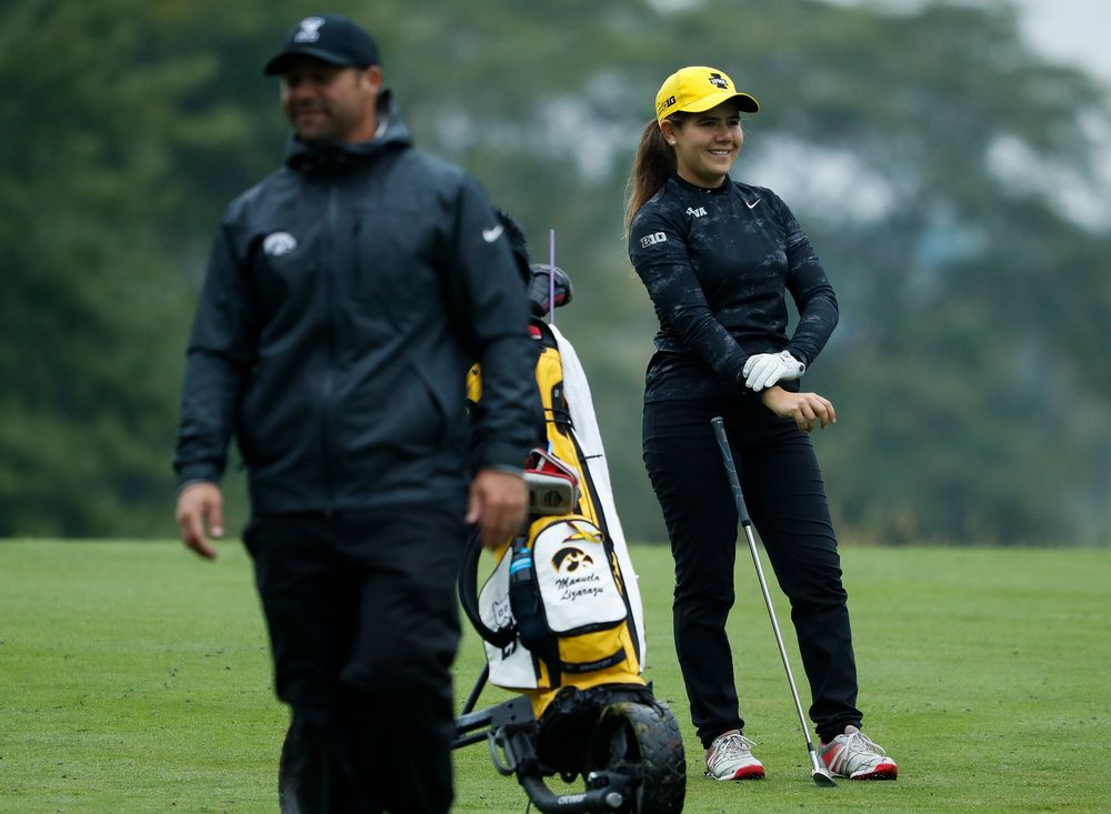 Iowa's Manuela Lizarazu laughs at a joke by assistant coach Michael Roters during the final round of the Diane Thomason Invitational at Finkbine Golf Course on September 30, 2018. (Tork Mason/hawkeyesports.com)