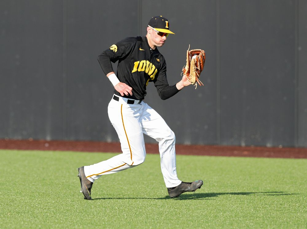 Iowa outfielder Ben Norman (9) fields a ball during the second inning of their college baseball game at Duane Banks Field in Iowa City on Tuesday, March 10, 2020. (Stephen Mally/hawkeyesports.com)