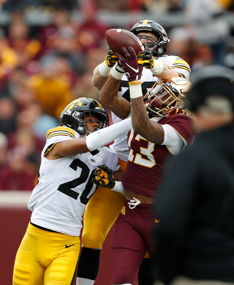 Iowa Hawkeyes defensive back Julius Brents (20) and defensive back Julius Brents (20) break up a pass against the Minnesota Golden Gophers Saturday, October 6, 2018 at TCF Bank Stadium. (Brian Ray/hawkeyesports.com)