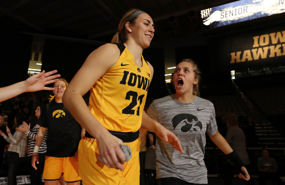 Iowa Hawkeyes forward Hannah Stewart (21) and guard Kathleen Doyle (22) against the Robert Morris Colonials Sunday, December 2, 2018 at Carver-Hawkeye Arena. (Brian Ray/hawkeyesports.com)