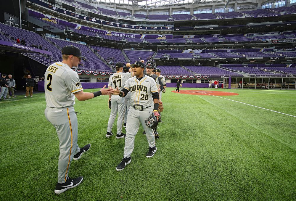 Iowa Hawkeyes infielder Brendan Sher (2) and infielder Izaya Fullard (20) greet each other after warming up before their CambriaCollegeClassic game at U.S. Bank Stadium in Minneapolis, Minn. on Friday, February 28, 2020. (Stephen Mally/hawkeyesports.com)