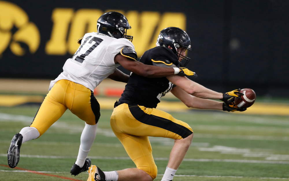 Iowa Hawkeyes tight end Drew Cook (18) and defensive back Cedric Boswell (17) during spring practice  Thursday, March 29, 2018 at the Hansen Football Performance Center. (Brian Ray/hawkeyesports.com)