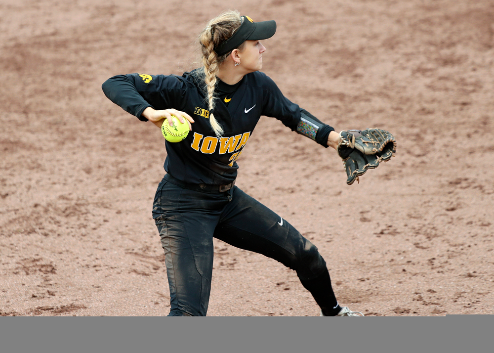 Iowa infielder Mia Ruther (26) throws to first for an out during the seventh inning of their game against Iowa Softball vs Indian Hills Community College at Pearl Field in Iowa City on Sunday, Oct 6, 2019. (Stephen Mally/hawkeyesports.com)