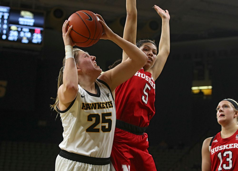 Iowa Hawkeyes forward Monika Czinano (25) makes a basket while being fouled during the second quarter of the game at Carver-Hawkeye Arena in Iowa City on Thursday, February 6, 2020. (Stephen Mally/hawkeyesports.com)