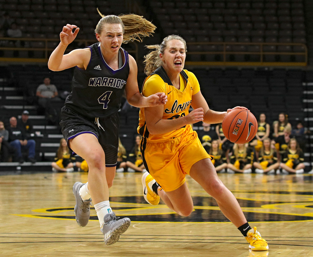 Iowa guard Kathleen Doyle (22) drives in before being fouled while making a basket during the fourth quarter of their game against Winona State at Carver-Hawkeye Arena in Iowa City on Sunday, Nov 3, 2019. (Stephen Mally/hawkeyesports.com)