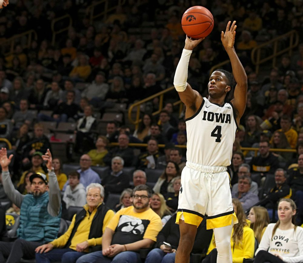 Iowa Hawkeyes guard Bakari Evelyn (4) makes a 3-pointer during the first half of their their game at Carver-Hawkeye Arena in Iowa City on Sunday, December 29, 2019. (Stephen Mally/hawkeyesports.com)
