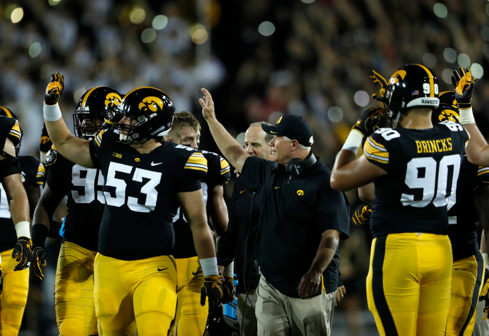 Iowa Hawkeyes defensive line coach Reese Morgan waves tot he Stead Family Children's Hospital against the Wisconsin Badgers Saturday, September 22, 2018 at Kinnick Stadium. (Brian Ray/hawkeyesports.com)