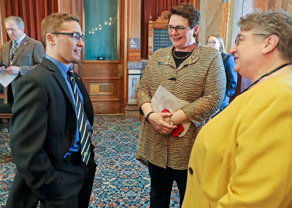 Iowa's Spencer Lee (from left) talks with State Rep. Vicki Lensing and State Rep. Mary Mascher before being honored in the House Chamber at the Iowa State Capitol Building on Tuesday, Apr. 9, 2019. (Stephen Mally/hawkeyesports.com)