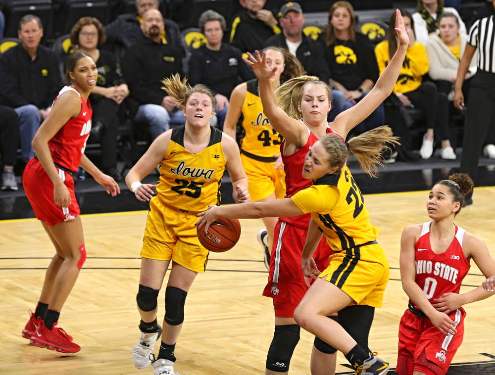 Iowa Hawkeyes guard Kathleen Doyle (22) passes the ball to forward Monika Czinano (25) during the third quarter of their game at Carver-Hawkeye Arena in Iowa City on Thursday, January 23, 2020. (Stephen Mally/hawkeyesports.com)