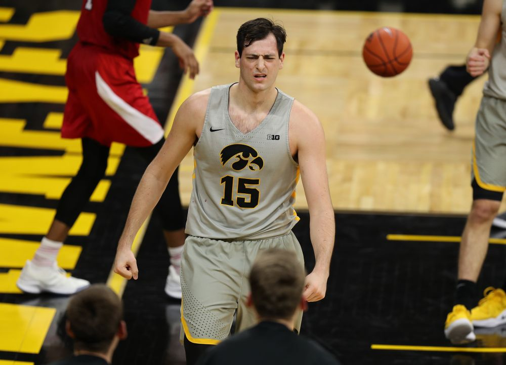 Iowa Hawkeyes forward Ryan Kriener (15) flexes after making a basket and drawing a foul against the Nebraska Cornhuskers Sunday, January 6, 2019 at Carver-Hawkeye Arena. (Brian Ray/hawkeyesports.com)