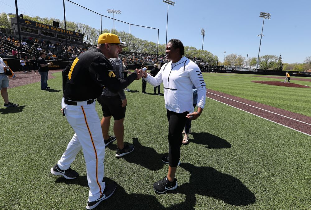 Iowa Track and FieldÕs Laulauga Tausaga throws out a first pitch before the Iowa Hawkeyes second game against UC Irvine Saturday, May 4, 2019 at Duane Banks Field. (Brian Ray/hawkeyesports.com)