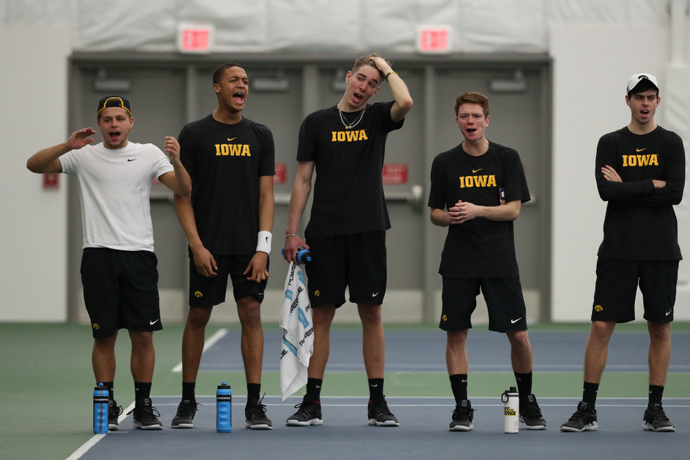 Members fo the Iowa Tennis team cheer on teammate Kareem Allaf against UMKC Friday, February 15, 2019 at the Hawkeye Tennis and Recreation Complex. (Brian Ray/hawkeyesports.com)