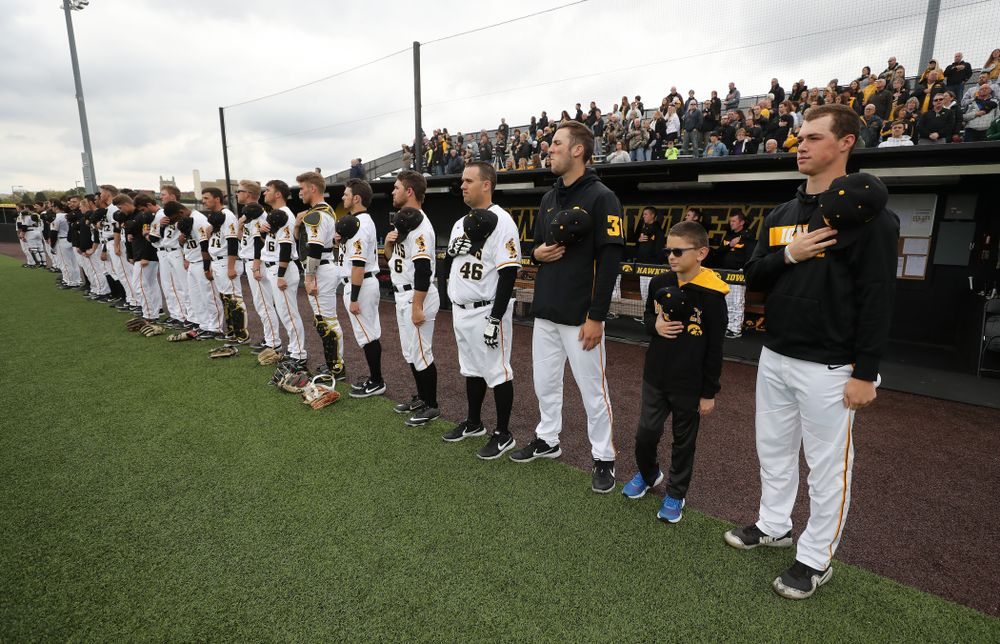 Garret Nichols stands with the rest of the team for the National Anthem before the Iowa Hawkeyes game against Michigan State Sunday, May 12, 2019 at Duane Banks Field. (Brian Ray/hawkeyesports.com)