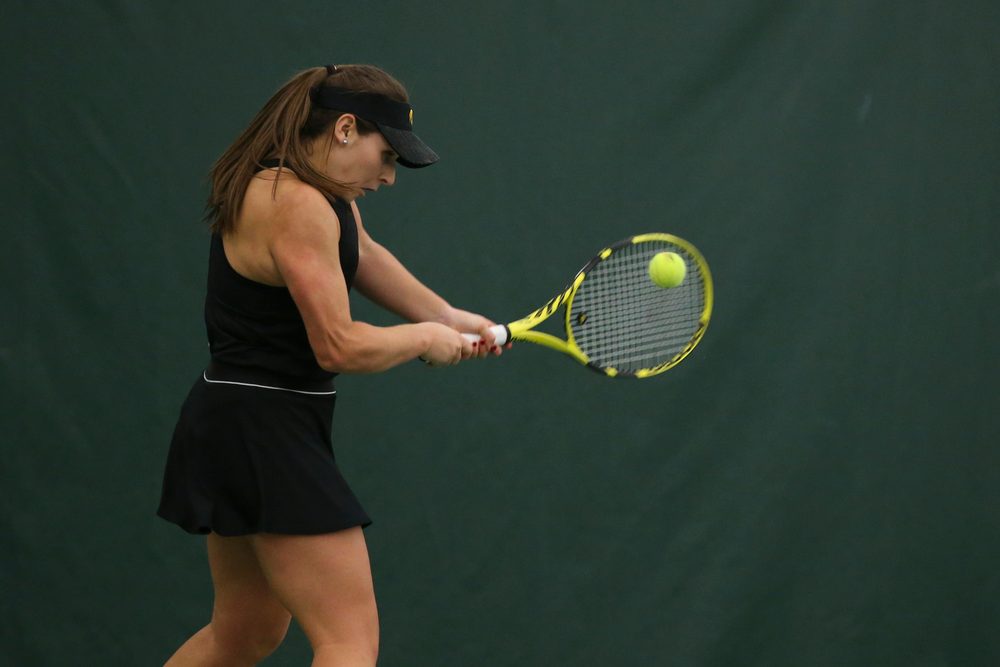Iowa's Danielle Bauers returns a ball during the Iowa women's tennis meet vs UNI  on Saturday, February 29, 2020 at the Hawkeye Tennis and Recreation Complex. (Lily Smith/hawkeyesports.com)