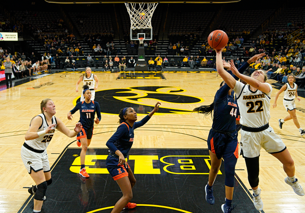 Iowa Hawkeyes guard Kathleen Doyle (22) scores a basket inside during the second quarter of their game at Carver-Hawkeye Arena in Iowa City on Tuesday, December 31, 2019. (Stephen Mally/hawkeyesports.com)